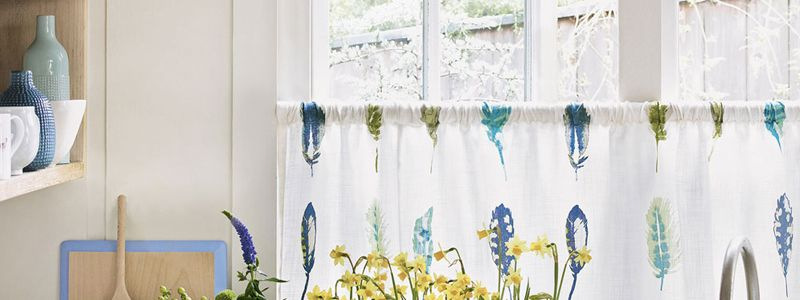 Cafe curtains are an affordable way to dress windows using cheap curtains and a simple pole perfect for kitchen curtains.