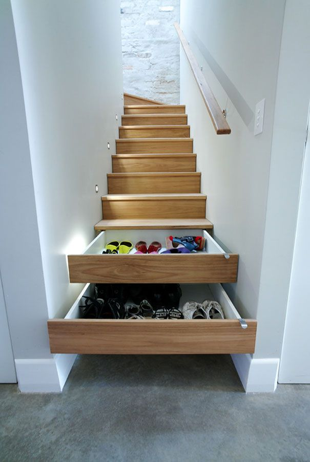 Space saving design - shelves and cupboards beneath the stairs