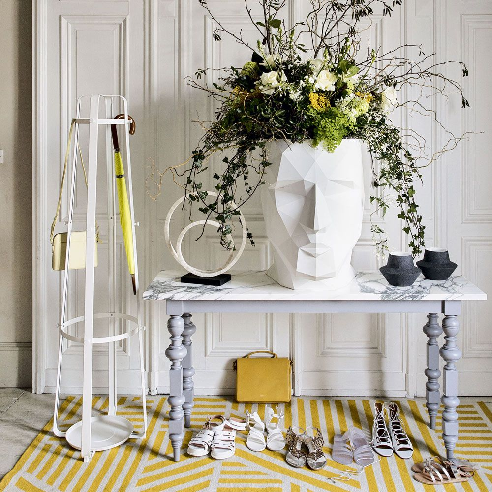 White-modern-hallway-with-console-and-yellow-rug