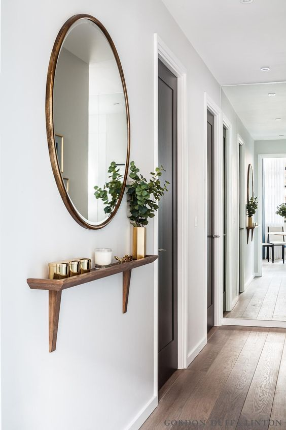 hallway circular mirror maple building