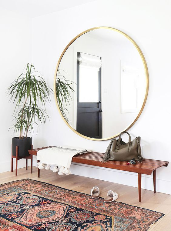 retro 70s entrance large mirror and rug