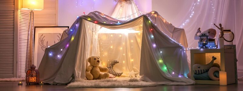 Pillowfort with fairy lights and teddy bears