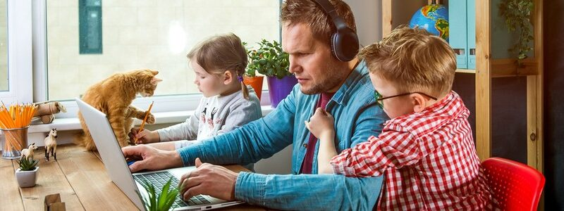 Man working from home with children annoying him